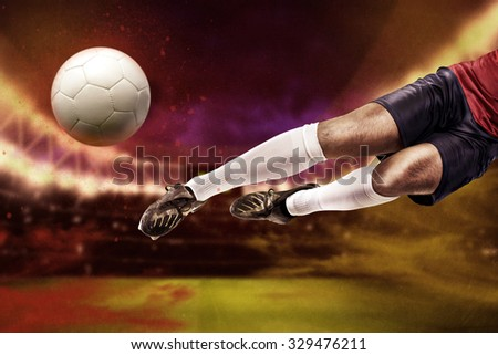 soccer or football  player on the field in front of space - stock photo