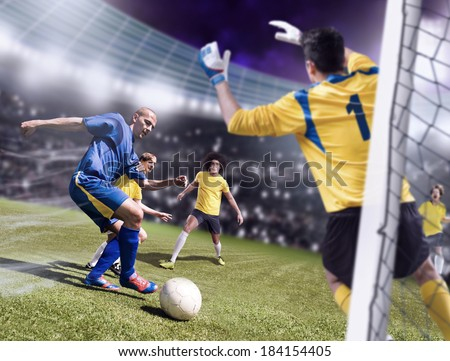 soccer or football players from opposing team on the field - stock photo