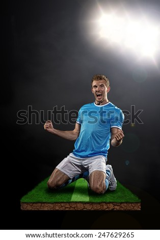 Soccer player celebrates after a goal - stock photo