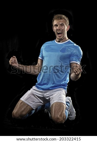 Soccer player celebrates his goal - stock photo