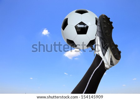 soccer player doing flying kick with ball