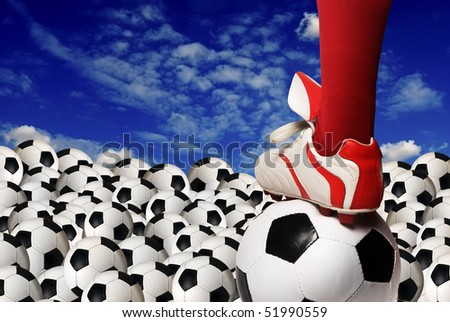 soccer player foot and balls