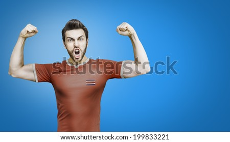 Soccer player from Costa Rica celebrates on blue background
