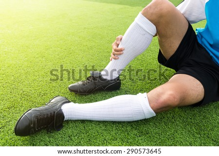 soccer player have pain injury accident on football match - stock photo