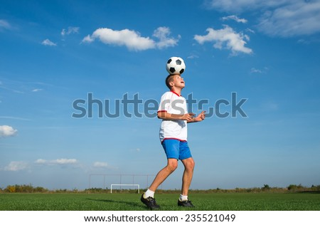 Soccer Player Head Shooting a Ball  - stock photo