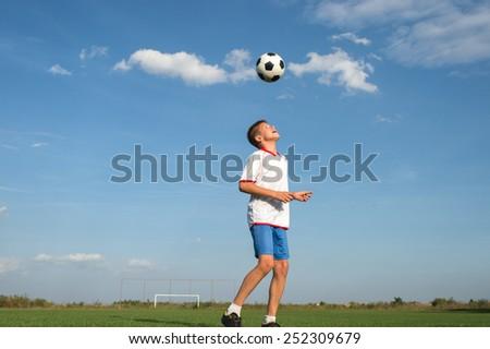 Soccer Player Head Shooting a Ball  - stock photo