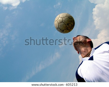 Soccer player heading the ball - stock photo