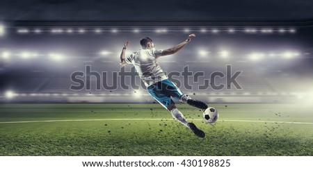 Soccer player hitting ball