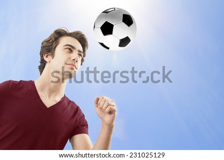 Soccer player hitting the ball with his head - stock photo