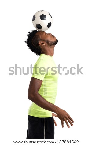 Soccer player holding a ball on his head - stock photo