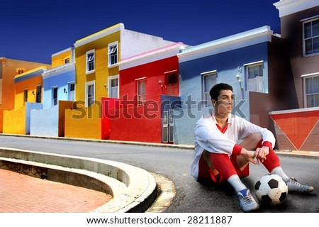 soccer player in a colorful street - stock photo