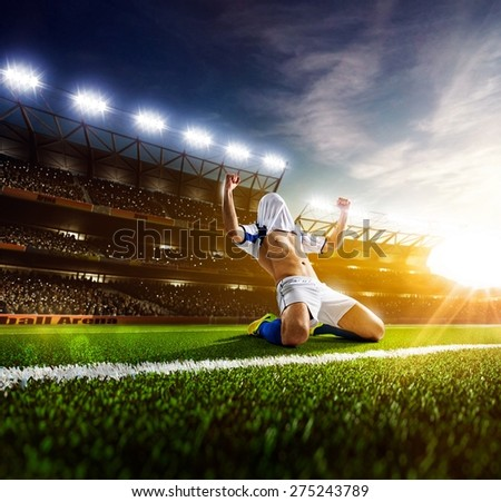 Soccer player in action on  stadium background - stock photo