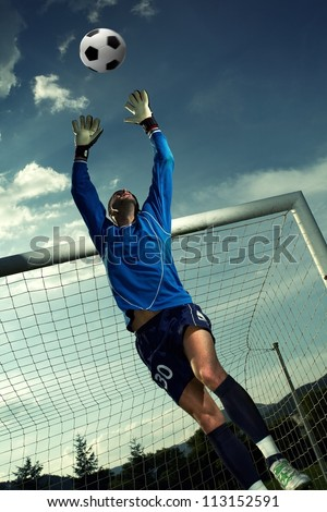 Soccer player in goal - stock photo