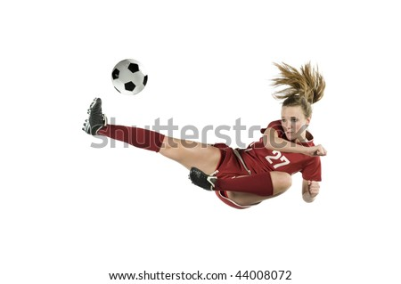 Soccer player in the air kicking the ball - stock photo