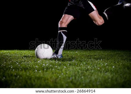 soccer player is going to kick the ball - stock photo