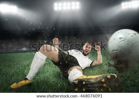 Soccer player is jumping through the ball