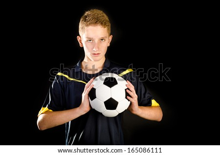 soccer player isolated on a black background
