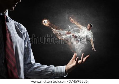 Soccer player kicking ball - stock photo