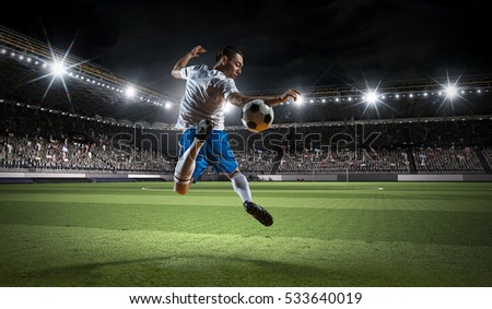 Soccer player kicking ball . Mixed media