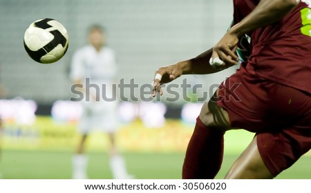 Soccer player kicking the ball - stock photo