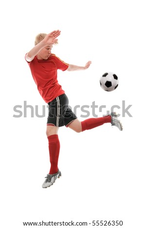 Soccer player kicking the ball isolated on white - stock photo