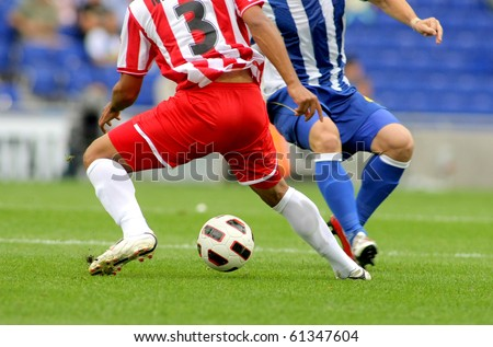 Soccer player legs in action - stock photo