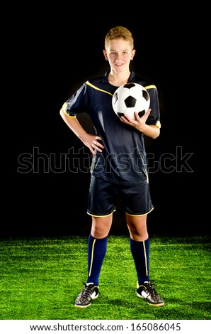 soccer player on a green grass  - stock photo