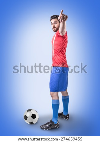 Soccer player on red and blue uniform on blue background