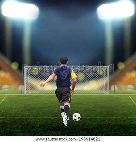 Soccer player on Soccer field - stock photo