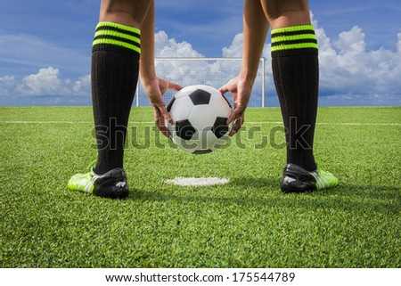 soccer player paste ball on green grass field, penalty - stock photo