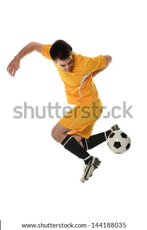Soccer player performing back kick isolated over white background - stock photo