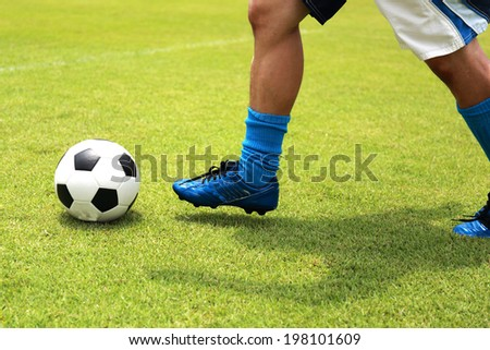 soccer player running with ball before shooting