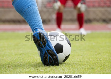 soccer player running with ball before shooting  - stock photo
