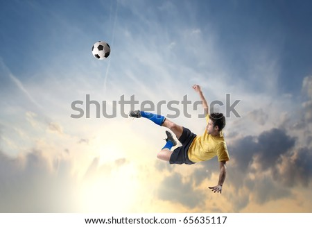 Soccer player shooting a football - stock photo