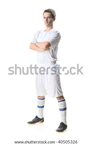 Soccer player standing isolated on white background - stock photo
