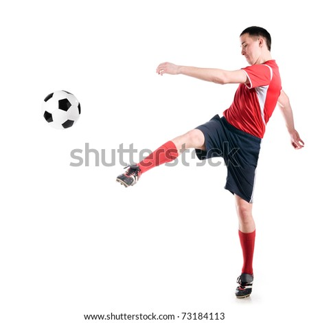 soccer player strongly hits the ball, isolated on white - stock photo
