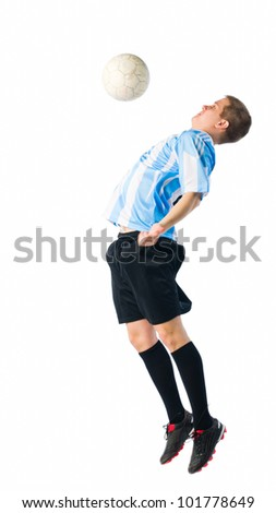 Soccer player trap a ball with his chest. - stock photo