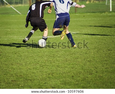 soccer players in action. in duel for the bal. - stock photo