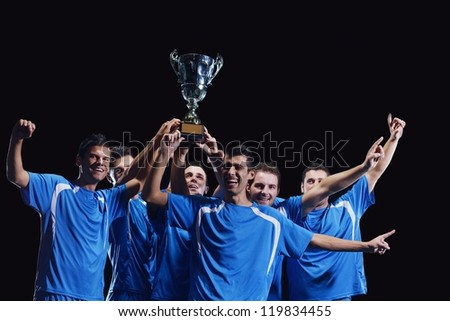 soccer players team group celebrating the victory and become champion of game while holding win coup - stock photo