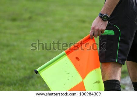 soccer referee hold the flag - stock photo