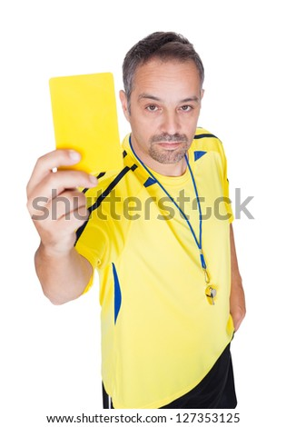 Soccer Referee Showing Yellow Card On White Background - stock photo