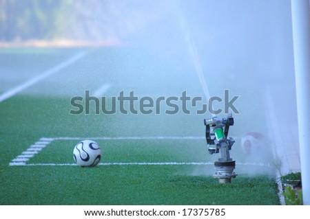 soccer scene, grass irrigation system - stock photo