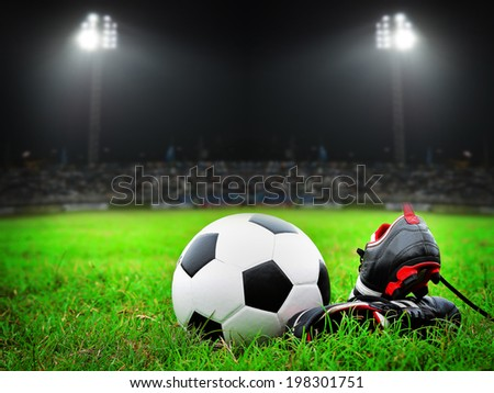 Soccer shoe with ball on the field - stock photo