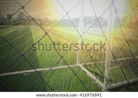 Soccer sport field with poles and net for recreation background - stock photo