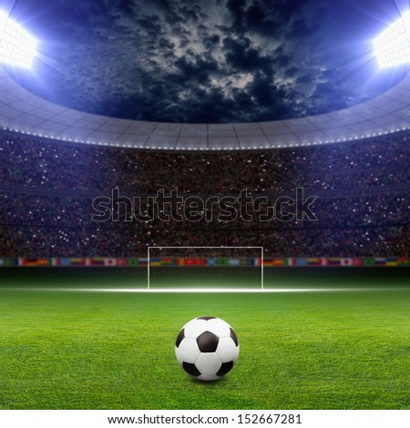 Soccer stadium, soccer ball on green stadium, arena in night illuminated bright spotlights, soccer goal - stock photo