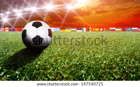 Soccer stadium with the flags - stock photo
