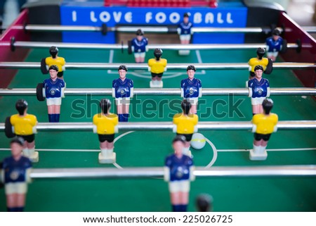 Soccer table with yellow and blue players