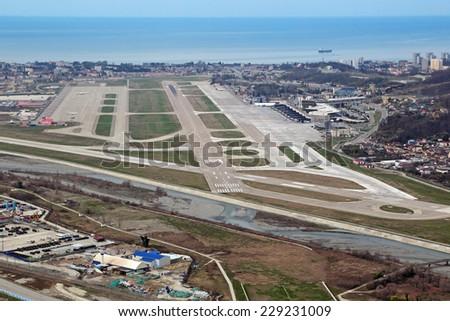 SOCHI, ADLER, RUSSIA - MAR 02, 2014: Runway Adler airport and Black sea, top view - stock photo