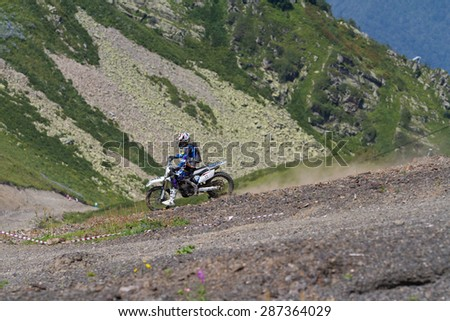 SOCHI, RUSSIA â?? AUGUST 16, 2014: Off-road motorcycle rider trains in summer mountains - stock photo