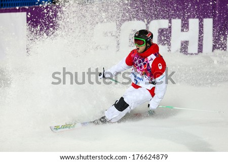 SOCHI, RUSSIA - FEB 10, 2014: Alex BILODEAU (CAN) at Men's Moguls Final of Freestyle skiing at Sochi 2014 XXII Olympic Winter Games - stock photo